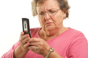 Woman Struggling With Cell Phone